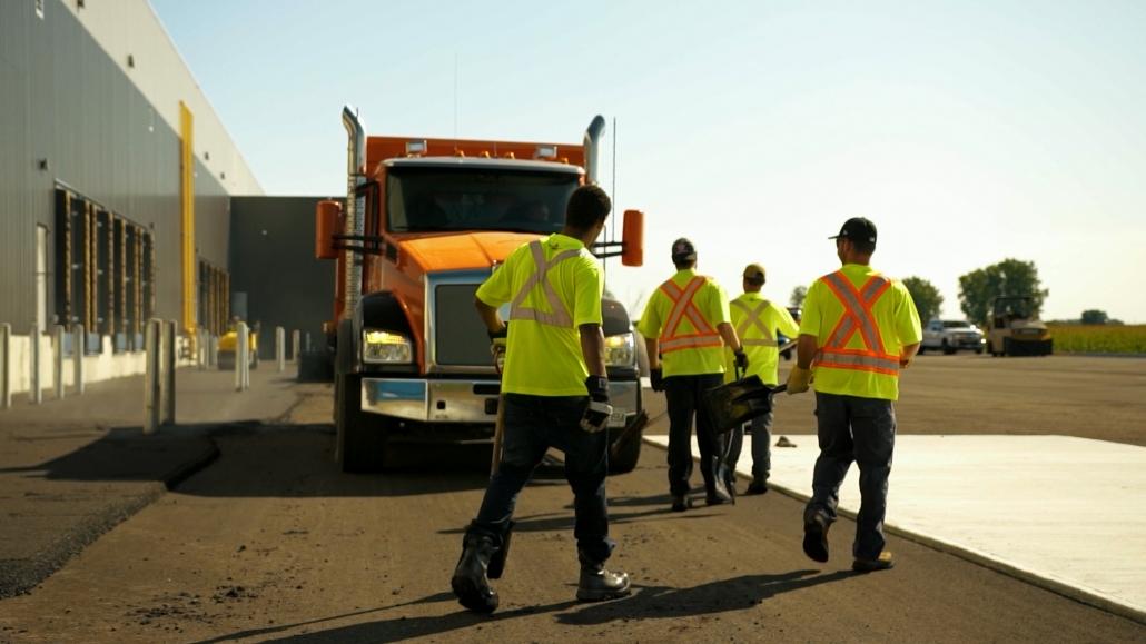 Asphalte JRL Paving truck and men at work in parking lot