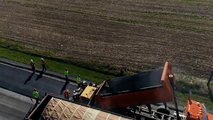 Asphalte JRL Paving grader and truck road aerial view