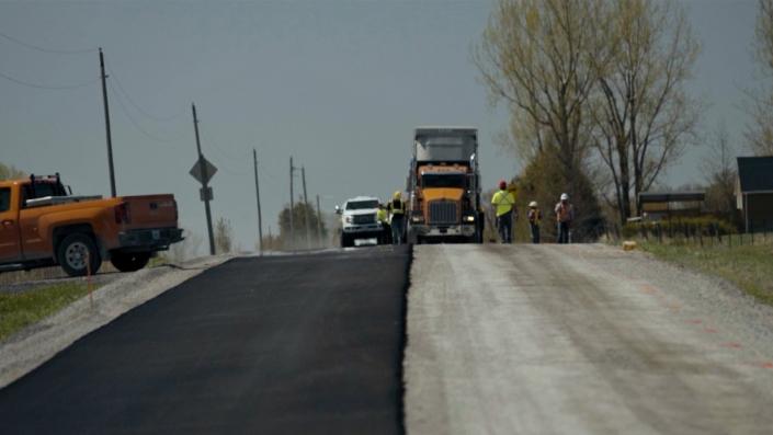 Asphalte JRL Paving men working and truck on road