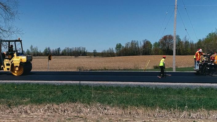 Asphalte JRL Paving grader and roller road view