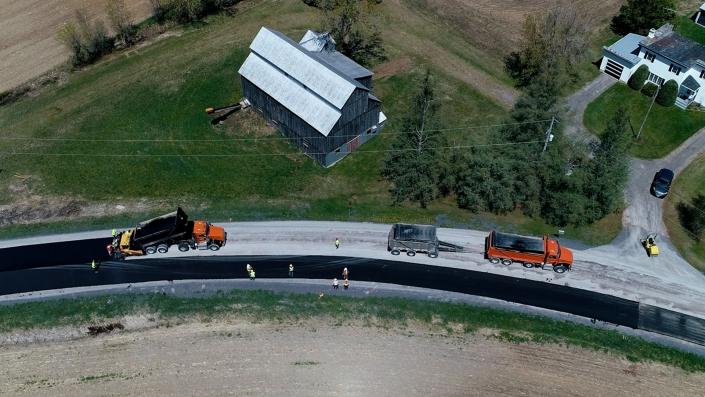 Asphalte JRL Paving grader with truck aerial view