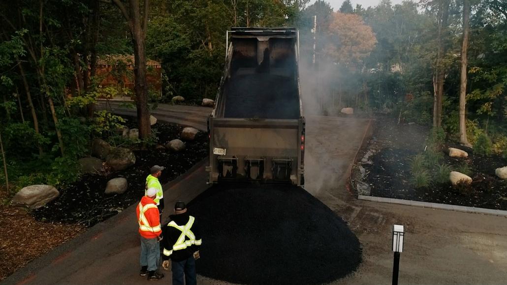 Asphalte JRL Paving residential driveway dumping truck