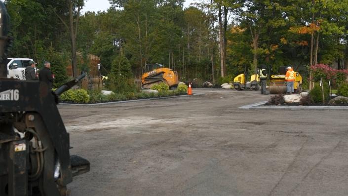 Asphalte JRL Paving residential driveway skid-steer and roller equipment