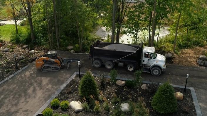 Asphalte JRL Paving residential driveway skid-steer and truck