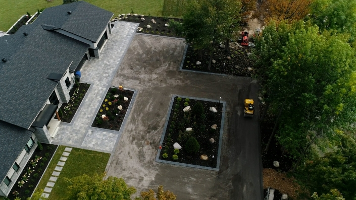 Asphalte JRL Paving residential driveway roller aerial view