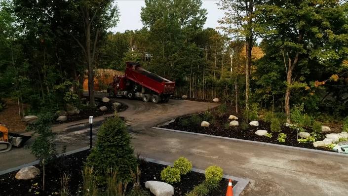 Asphalte JRL Paving residential driveway skid-steer and dumping truck