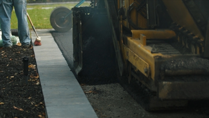 Asphalte JRL Paving residential driveway man with roller and grader